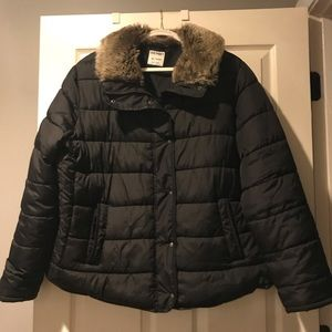 Black puffer jacket with faux fur collar.